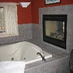 A closer look at the two way fireplace and huge two person tub.