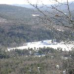 View from Bald Ledge snowshoe trail of a nearby farm where the sleigh rides are done