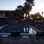 Barefoot Bay-pool area-sun is rising