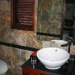 bathroom with stone-walls