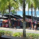 view of beach and street vendors from balcony