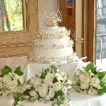 The cake was set up in a gorgeous room with large mirrors reflecting the grounds