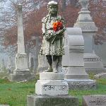 Statue of Mary Ella McGinnis, one of over 100 statues at Crown Hill