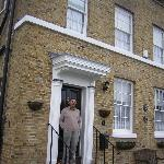 The outside of the place, a recent side addition to an 18th-century house, with proprietor Tony.