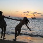 dancing on the beach at sundown