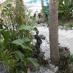 statue on walkway by the pool
