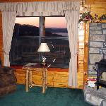 window overlooking lake and fireplace cabin 6