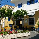 Taverna with hotel entrance behind