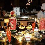 Watermellon sculptures near sushi bar