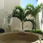 indoor bathtub with view of outdoor shower