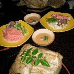 the parcel wrapped in lotus leaf is soup in a conch shell