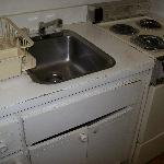 Kitchen sink and broken cabinet