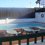 view of pool from the front patio of apartment 1