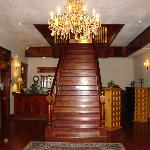 The beautiful sweeping staircase leading to the upper rooms
