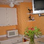 The mini-kitchen & TV in Coral Suite