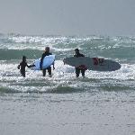 surfing chesterman beach, near tofino bc
