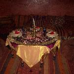 Our table laid for supper, complete with rose petals