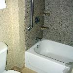 bathtub with handrail in our handicap accessible room