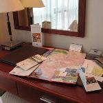Desk has stationeries and map for tourist