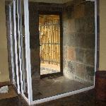 Huge inside shower and door to outside shower
