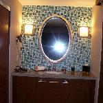 Bathroom vanity outside of main bathroom