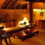 at night in the open air area of the master suite, sofa & kitchen