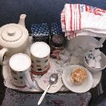 Tea tray and refreshments in room.