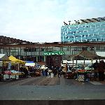 Flea market in Bos En Lommer square, with the Blue Tower Hotel rising behind it