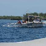 One of the boats that transport you from Hilton Pier to Olango Island