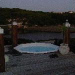 Heated hot tub on the deck overlooking the river & sea