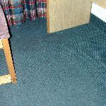 Dirty carpet under the desk