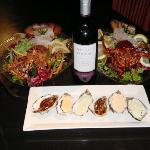 Our Lobster Sashimi's, oyster to share and wine.