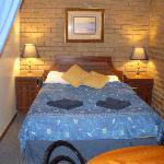 Queen bed in family room