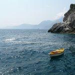 A small fishing boat in the bay near Torre di Grado