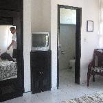 closet, tv, enterance to b.room, chair