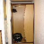 wardrobe next to the entry to bathroom, air conditioning