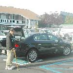 Father by the hire car and pool