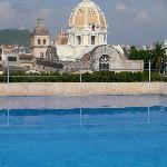 Rooftop infinity pool, view of dome of St. Peter Claver Cathedral
