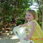 My daughter sitting on the deck.  You can see a small portion of the garden in the background.