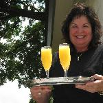 Owner - Judy serving drinks at hot tub