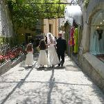 Walking thru Positano street to reception on beach on Wedding Day