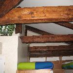 Wooden beams above the loft beds.