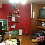 The living room with couch and TV and signin board