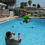 Older son taking flight in pool