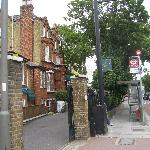 Outside hotel towards Clapham Common, including bus stop