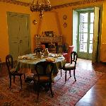 The house is furnished with antiques and paintings. This is the breakfast room.