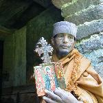 Priest displaying treasures