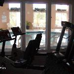 the workout room overlooking the pool