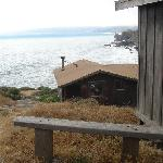The bench outside our cabin, with Stinson Beach in the background