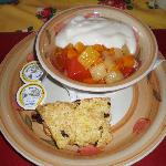Breakfast: scone, yogurt, and canned fruits